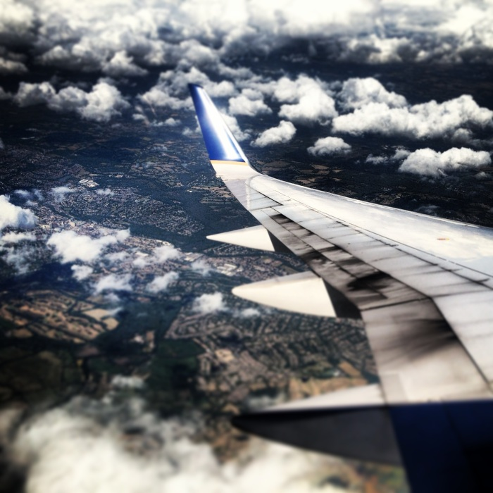 Plane window view of clouds